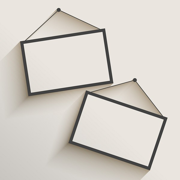 blank photo frame hanging on wall