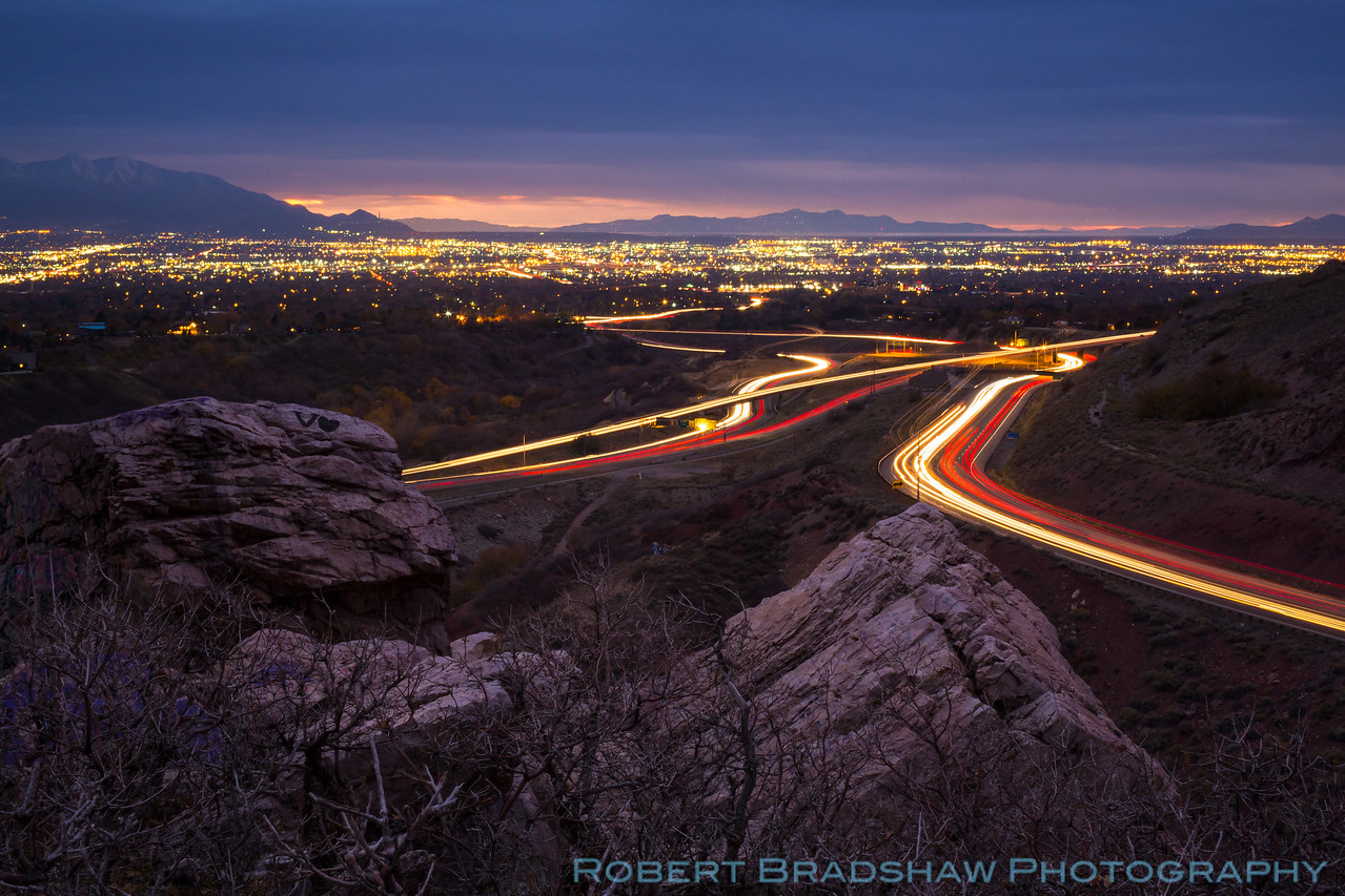 Rivers of vehicle lights flow through the mouth of Parley's Canyon