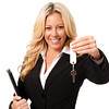 Young Businesswoman with Folio and Keys on White