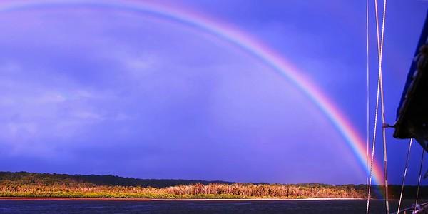 Vibrant  Rainbow  blue sky/over water
