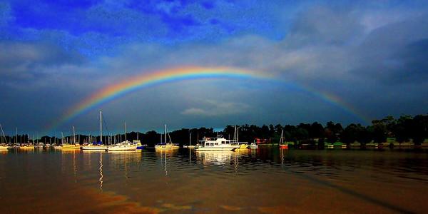 Vibrant Rainbow over water.
