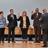 The newly elected and re-elected board members taking the Oath of Office