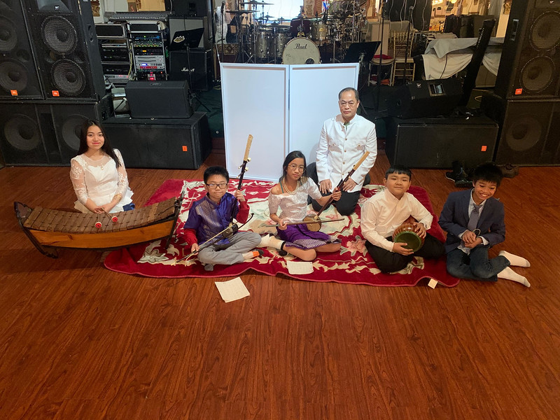 Master musician Sovann Khon of Lowell with his musical performers, CMAA Youth