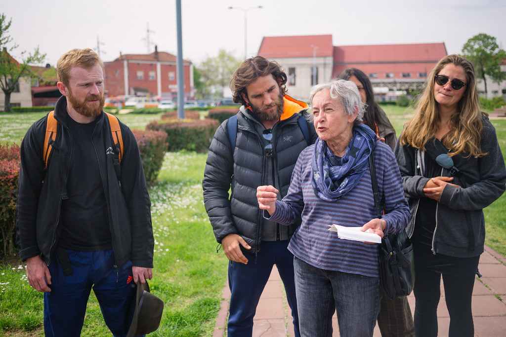 Inge (Germany) telling a history connected story in front of the concentration camp.