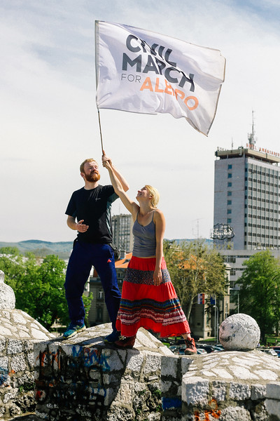 Anna (founder of the march) and co-founder Jan posing with flag on the city walls.
