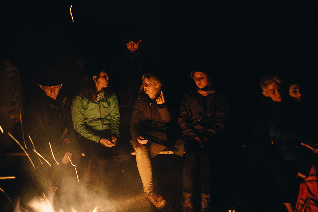 CMFA group by the fire.