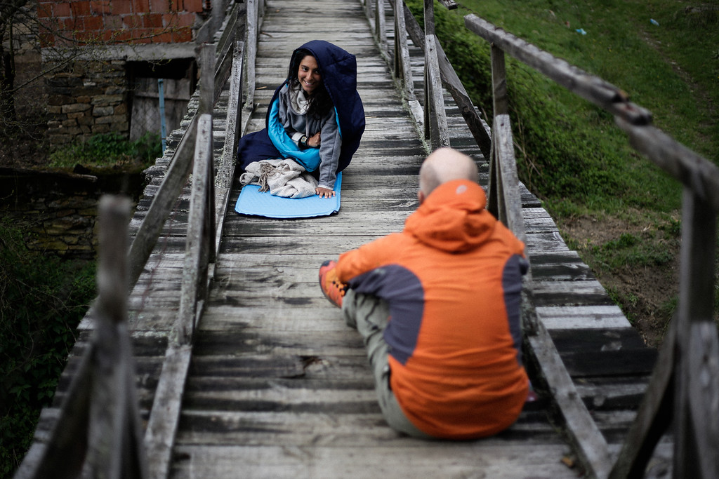 Antoine and Ismahan (both French) resting on the hanging bridge.