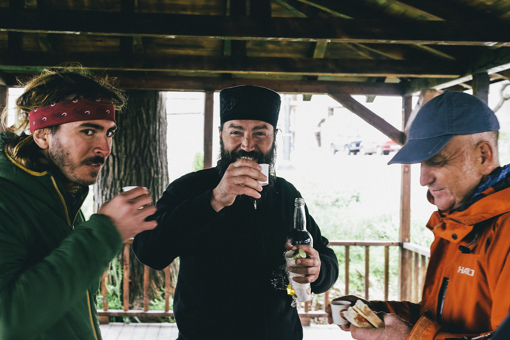 Tasting rakija with orthodox priest in Staro Nagorichane.