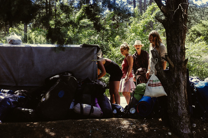Clara, Helena (Czech Republic), Eliza and Lucas unloading Habibi's trailer in search of swimming suits.