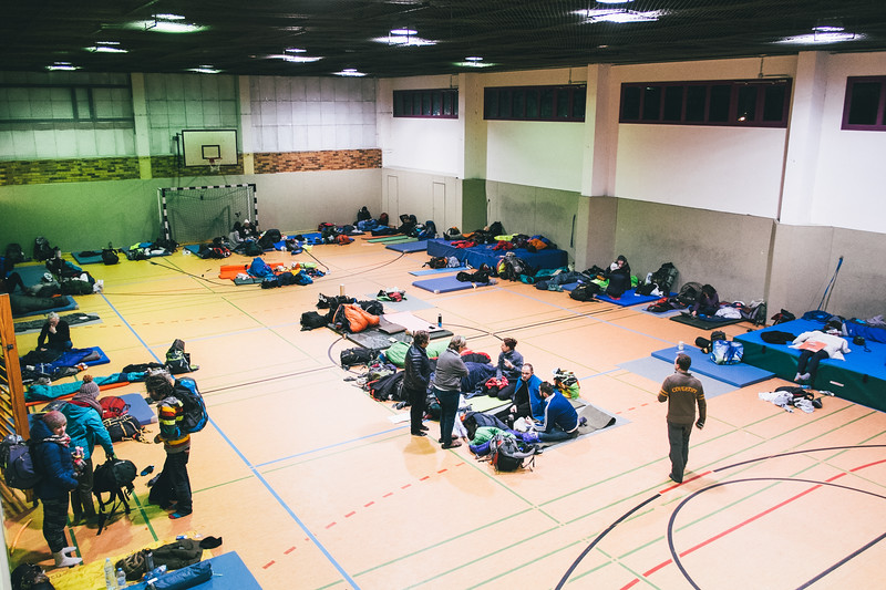 Tired marchers settled their sleeping materasses on the floor of the sport hall - our accommodation place.