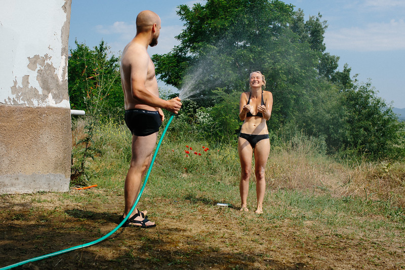 Anna (Poland) takes a hot shower in a hot day, middle of the summer in Greece.