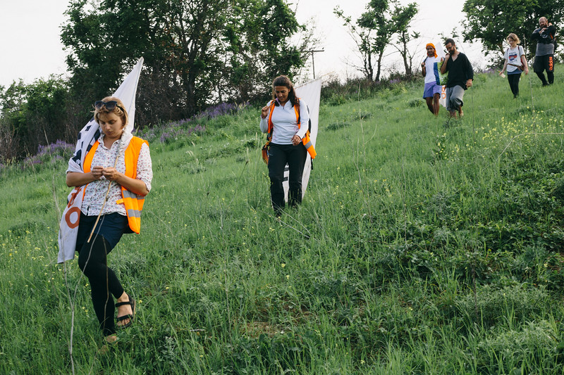 Marching across the hills to shorten the route.