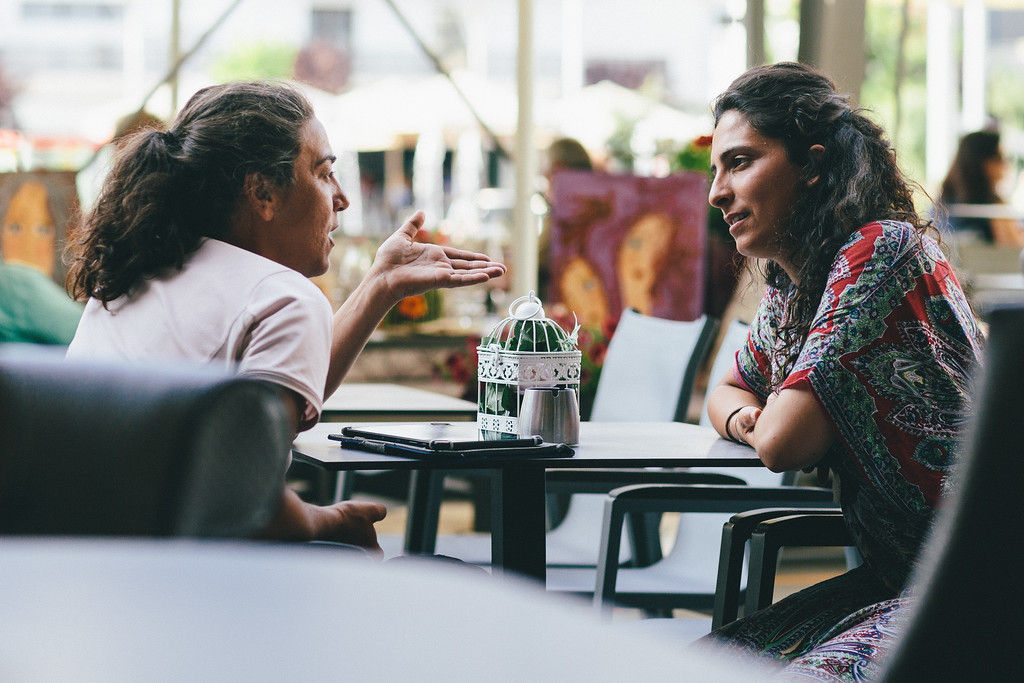 Ismahan and Malika discussing during the lunch break.