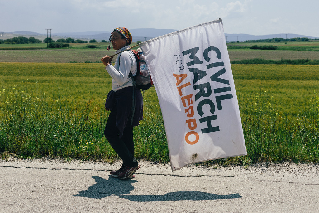 "Malika ""Queen of the CMFA"" marching through Greece. She has taken part in the whole journey, starting from Berlin, ending in Lebanon, only with small breaks."
