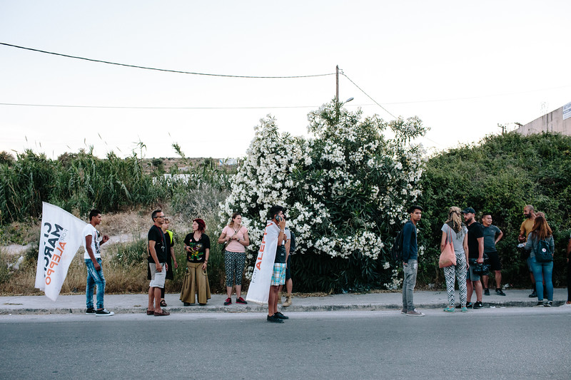 Marching crowd; Mitlini, Greece.
