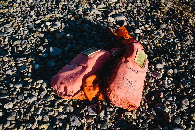 Life vest thrown out by the sea on Petalides beach, Samos, Greece.  In 2016 Turkish police have uncovered a factory producing fake lifejackets, a booming industry that has emerged as a byproduct of the refugee crisis. This heightened the risks for those hoping to reach Europe by sea.