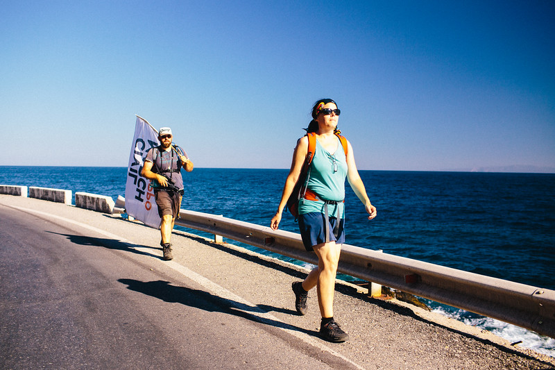 Denis and Cornelia (Germany) marching along the coast of Samos.