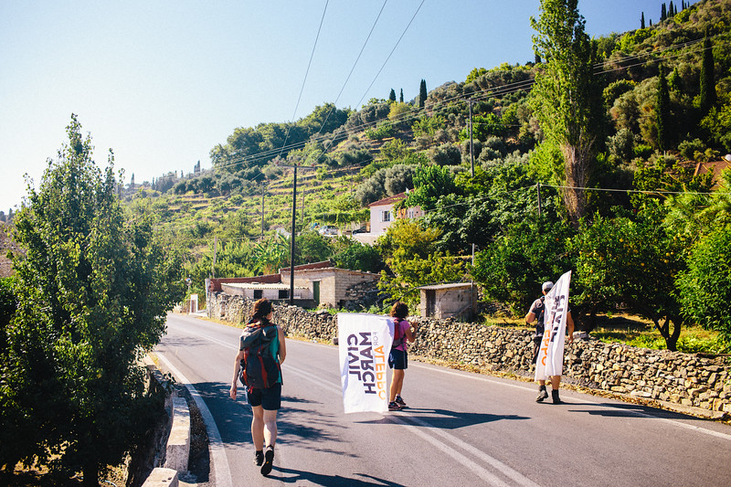 Cornelia, Denis and Malika marching along the coast of Samos.