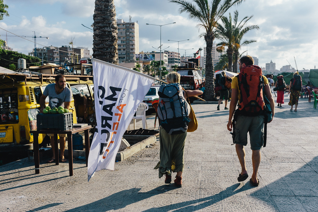 Marching along the Tyre corniche.