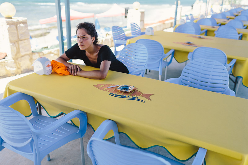 Ismahan taking rest in the restaurant. Our passports and camera cards were controlled by security forces and Hezbollah reps.