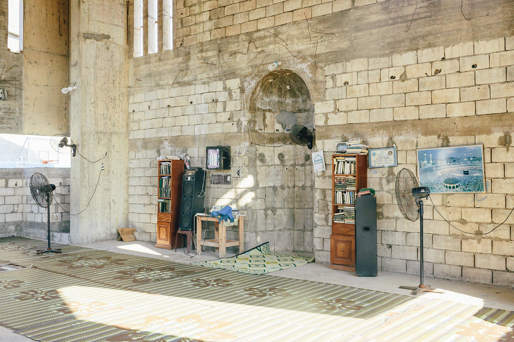 Faithful prayers are performed every day in the unfinished mosque beside the main Ouzai complex building.