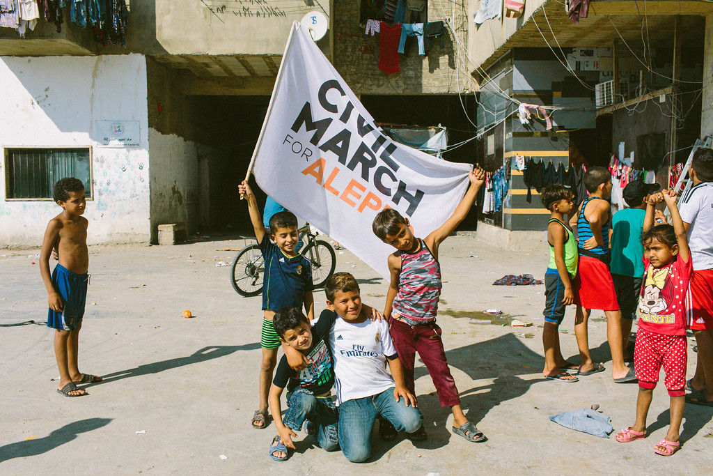 A group of Syrian kids posing with the CMFA flag.