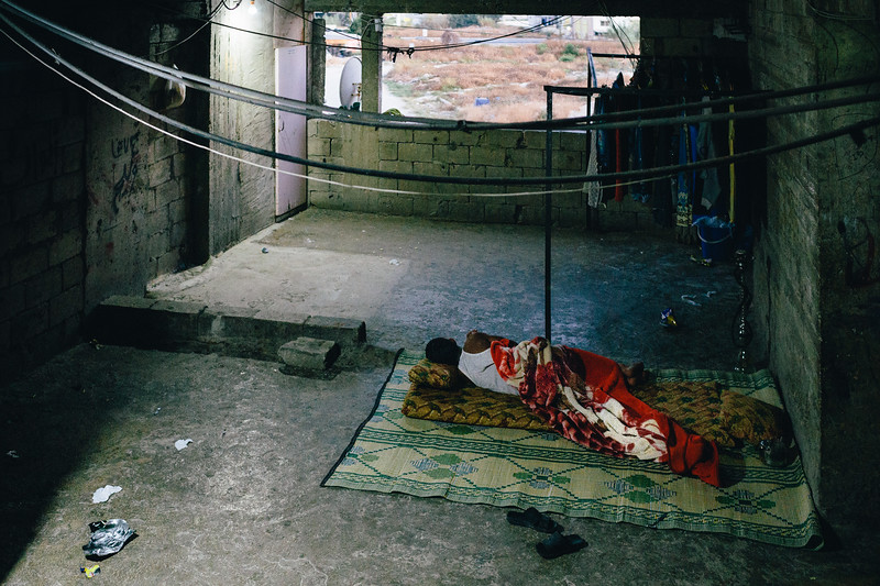 Sleeping inside the refugee complex.