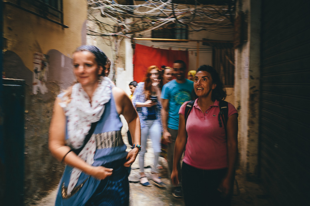 Malika (France) astonished by the vibrant look of the Sabra/Shatila district. Extremely narrow streets, shadow-light play, filled with satured colors and covered with dust and a maze of electrical and internet cables.