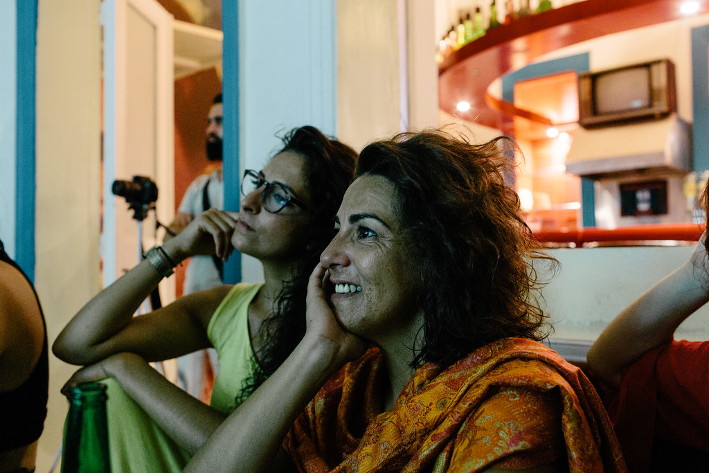 Ismahan and Malika (both France) watching the photographs from the CMFA in Zico House.