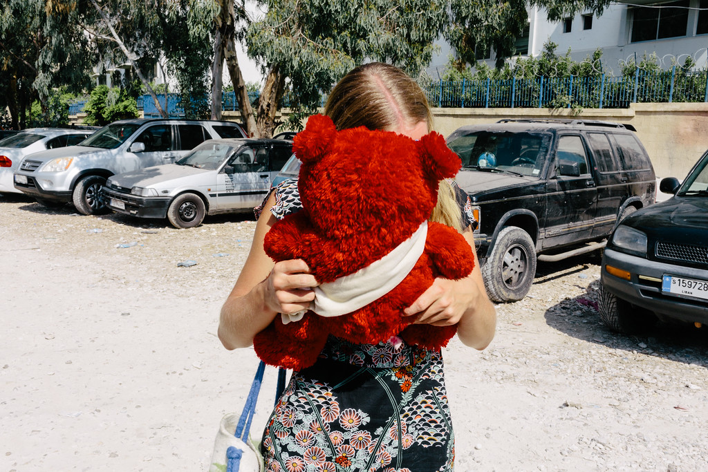"Feli (Germany), ""Princess"" hides behind ""Zosia"", the teddybear, that was a gift from Polish children for a Syrian refugee. Poland, an EU member, in the period from 01.01.2017 till 01.06.2017 accepted 11 (eleven) Syrian war refugees."