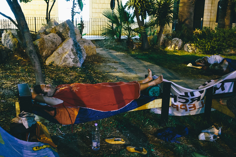 "Malika (France) sleeping in the Jounieh police station garden. She commited to find an accomodation for this day but when the marching group arrived nothing was yet arranged. Besides of swimming pool in a 4 star hotel for the ""Queen of the march""."