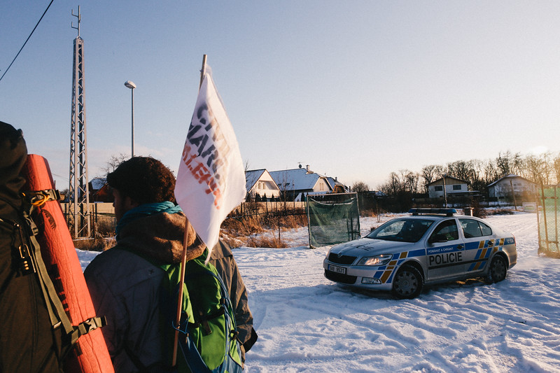 Czech police securing the group, on the way to Svetice, Czech Republic.