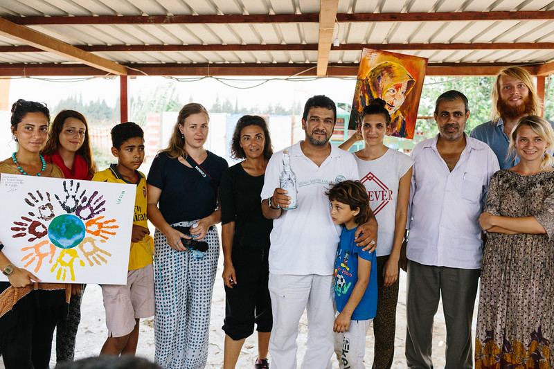 Posing to a group photo with the bottle full of wishes for the refugees.
