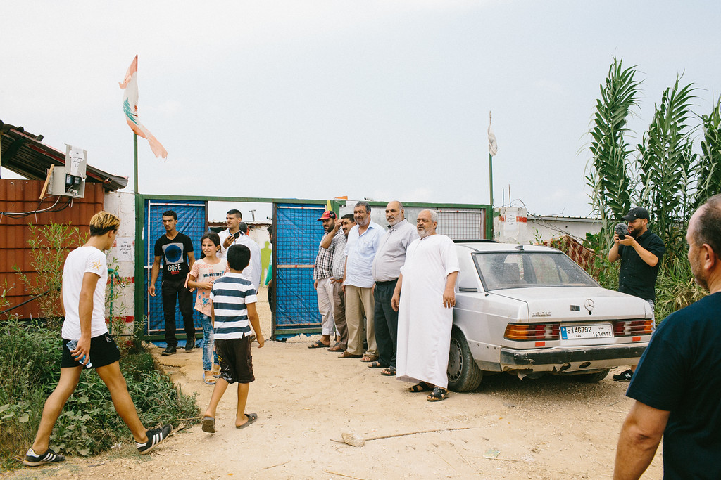 Syrian men welcoming at the gate of Malaak educational center.