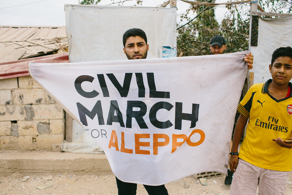 Syrian from Aleppo posing with the CMFA flag.