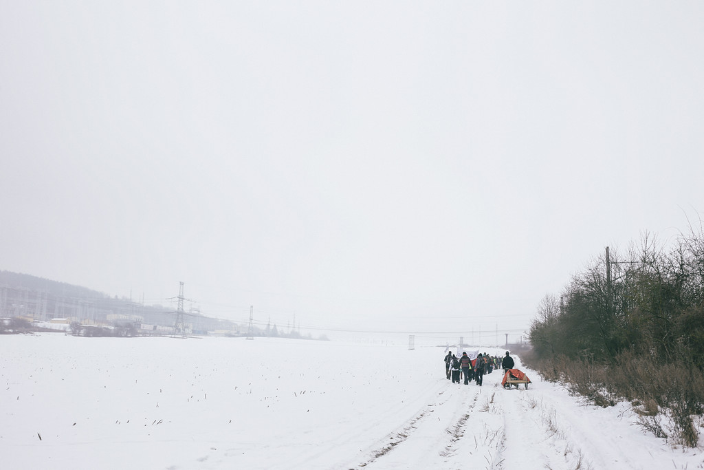 Soon the group left the town and started to move along a side road.