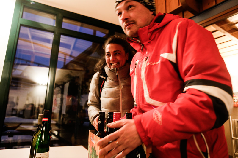Malika (France) and Krzysztof (Poland) with a freshly bought box of wine.