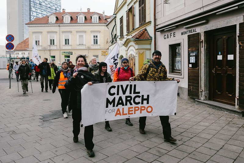 CMFA leaving Graz. Kati (Germany) and Bruno (Poland) holding the banner.