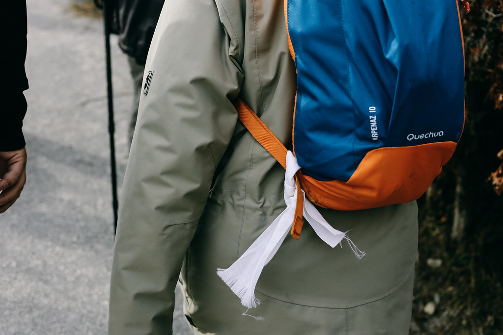 Peace symbol attached to a backpack.