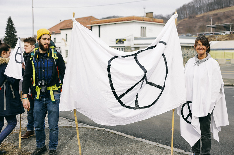 Eva (Slovenia), dressed all in white, was waiting for the group with a huge peace banner.