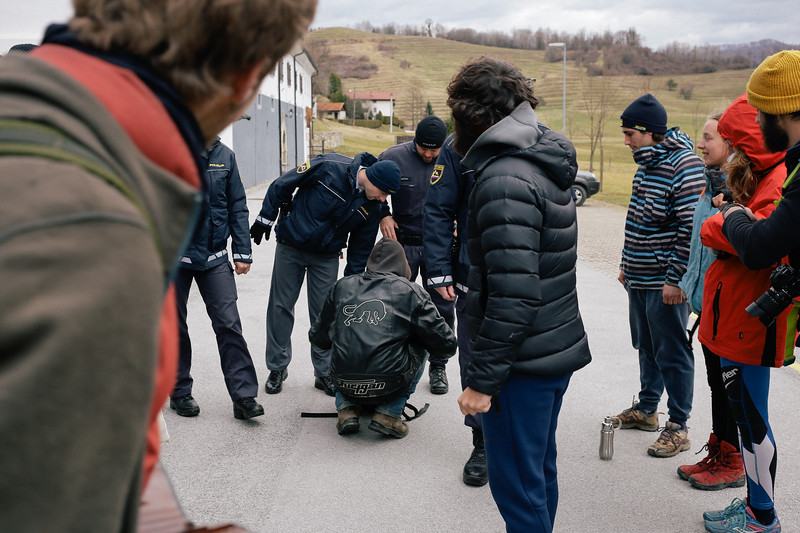 Frederic (France) showing his backpack to the Slovenian policeman.