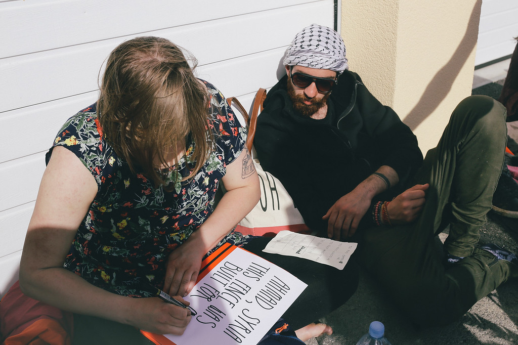 Wika (Poland) and Ahmad (Syria) preparing cards for the fence event.