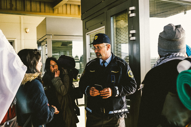 The border police officer explaining that not everyone from the group can pass the border in Rigonce.