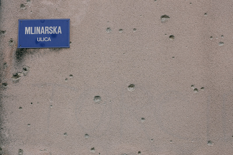 Bullet holes on a destroyed house in Hrvatska Dubica, from war 1991-1995.