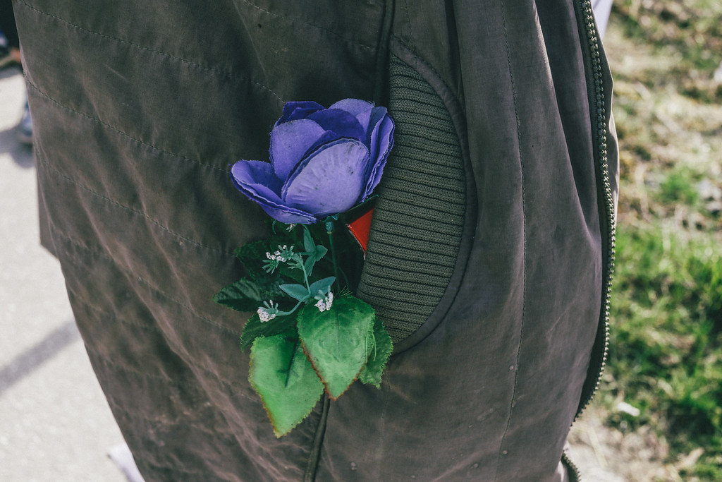 Anka (Poland) carrying a plastic rose that she found on the way.