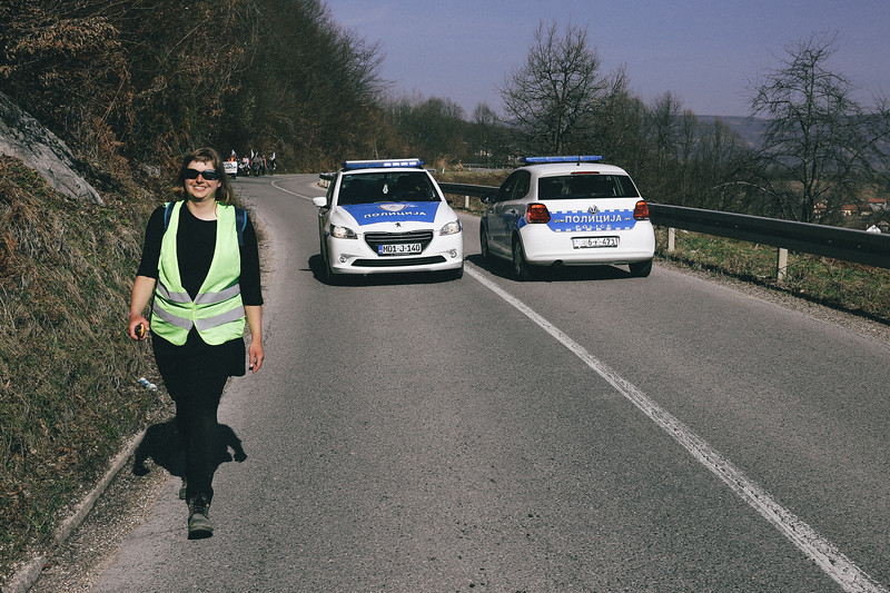 "Road R414 - Banja Luka - Knezevo. Wika (Poland) as a ""front security"" watching for the incoming cars. Curvy, narrow road with a lot of traffic caused a lot of risky situation for the marching group."
