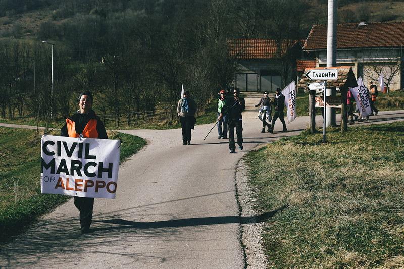 The group marching towards the bigger road.