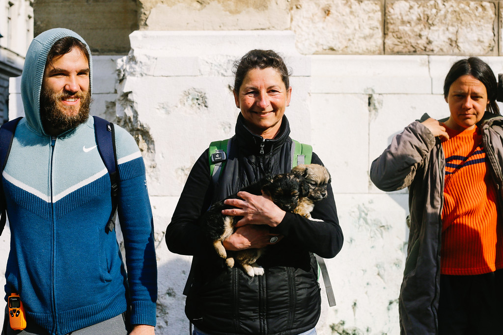 CMFA circle at the cathedral in Sarajevo, Bosnia and Herzegovina. Edgard. Ilde and Anka. Ilde is holding two puppies Banja and Luka that we founded on the way. They stayed with the march for a couple of days.
