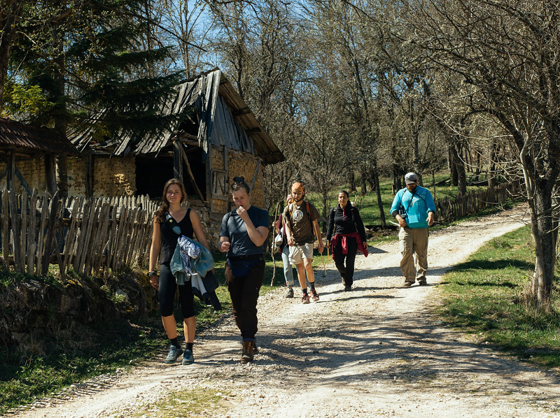 Clara, Suzanne, Jannis, Ismahan, Malika and Denis marching through a village, towards the border.