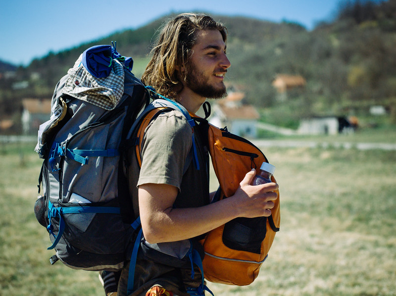 Jannis (Germany) wearing his personal and the second, orange, marching backpack.